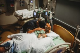 Partner supports woman during labor and birth at a Los Angeles hospital.