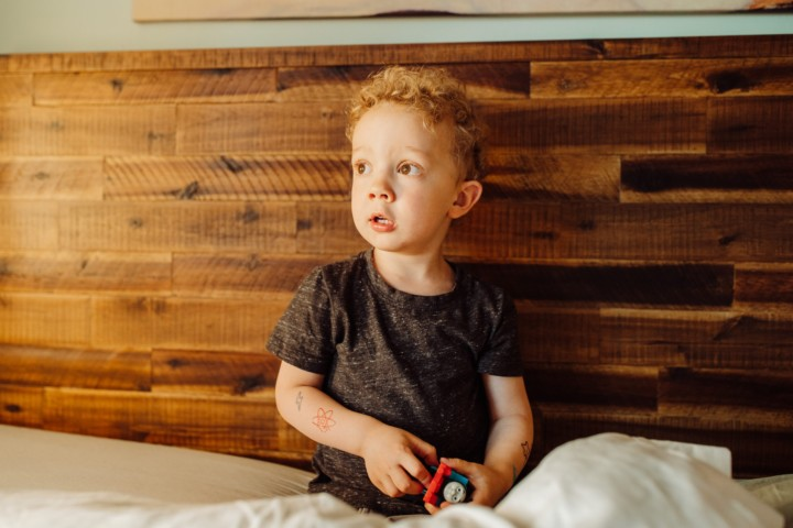 Lifestyle photos of child in home on bed